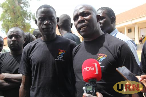 Jobless brotherhood activists, Augustine Ojobile and Robert Mayanja hold a presser outside Jinja chief magistrate court.