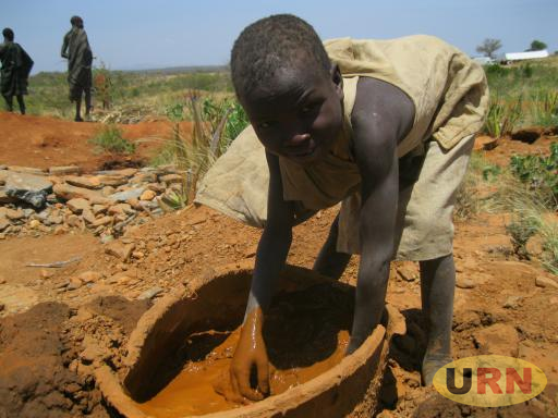 A boy in the Rupa gold mine in Moroto. The mining keeps children away from school