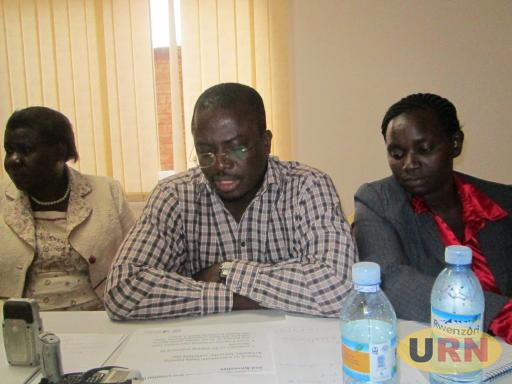 Lucy Lapoti (right) at a meeting of Northern Uganda Transition Justice Working Group