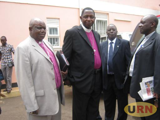 Bishop Stanley Ntagali (centre) at Namirembe Archbishop's Palace on Friday. The House of Bishops on June 22, 2012 elected Ntagali the 8th Archbishop of the Church of Uganda.