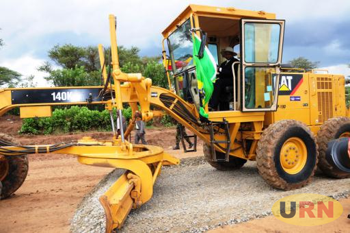 President Museveni operates a grader at the ground breaking of Moroto- Nakapripirit road.