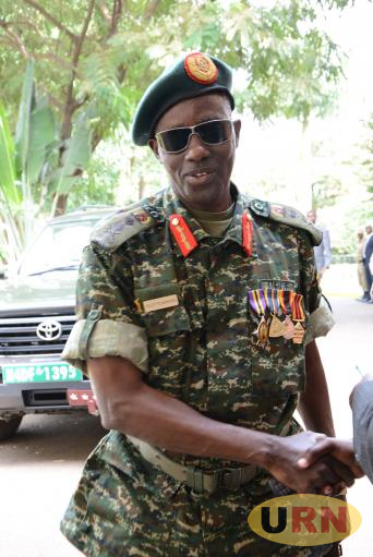 General Elly Tumwine decked out in medals
